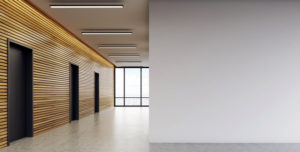 Timber panelling in a lift foyer.